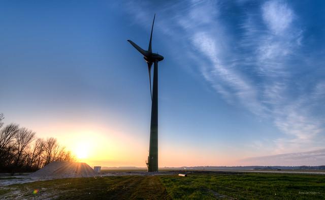 Wind turbine letting solar energy go to waste.