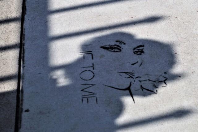 Woman's Silhouette Over Street Art