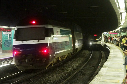 Southbound KTT passes through Mong Kong East station, 'white head' locomotive at the rear