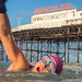 Swimming club member swimming past Brighton Pier by lomokev