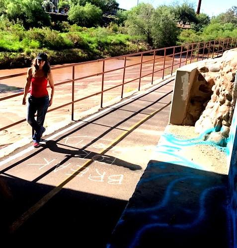 Elizabeth Salper chalking along the Santa Cruz River.