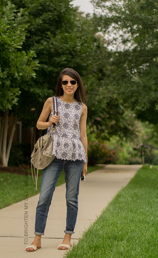 white floral embroidered peplum top, boyfriend jeans, gold jewelry, gray tote with navy and white strap, sandals with fringe embellishments