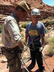 SLCSE Outdoor Exploration instructor Cavett Eaton and camper Leo at the rappelling station
