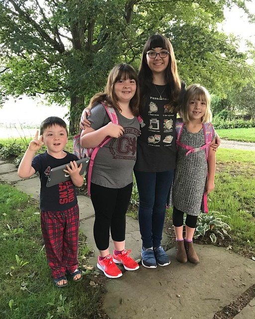 It's the first day of first grade for Bee, fourth grade (and middle school) for Lu, and eighth grade (and high school) for Julia. Jack doesn't start school for two weeks, so he's still in his pajamas.