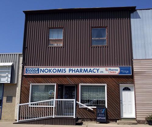 canada saskatchewan sk nokomis building pharmacy liquor sign shopping prairie cameraphone 2017 thisdecade canadagood colour color brown blue text