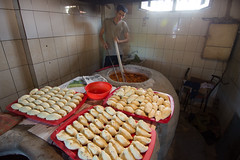 Burek and other pastries cooking in a Tandoor.
