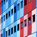 Building with red, pink and blue by Jan van der Wolf