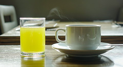 Cup of coffee with glass of fruit juice