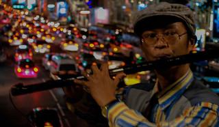 Street musician in Bangkok