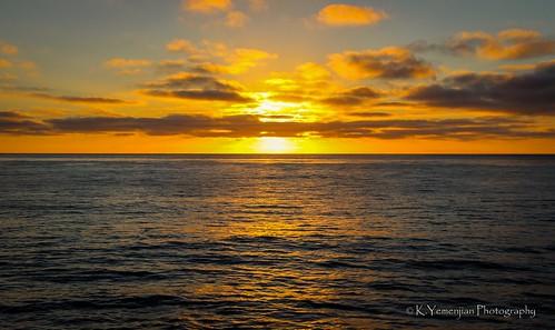 sunset sunlight sunbeam sun sandiegoca sandiego lajolla lajollaca lajollacove pacificocean water oceanview ocean waves reflection wat cloudy clouds orange orangecolor orangesky canon t5i canont5i 700d canon700d placescity