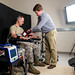 Biomedical engineer Ethan Blackford attaches sensors test subject Staff Sgt. Josh Whicker to collect biometric data in conjunction with video at the Air Force Research Laboratory at Wright Patterson Air Force Base in Dayton, Ohio. The research is for the development of imaging sensors that can determine an Airman's physical and mental state. (U.S. Air Force photo by J.M. Eddins Jr.)