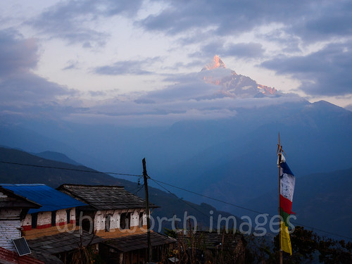stone houses sunrise asia himalaya machhapuchare himalayas hills slate clouds machhapuchchhare morning trek fishtailmountain pokhara indiansubcontinent buildings nepal kaski outdoors dawn sky village dhampus traditional