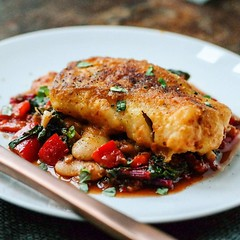 Meat + fish combo: #Homemade pan fried harissa #cod served on a bed of #nduja red pepper, rainbow chard, spinach and butter beans. A few #anchovies and a squeeze of lemon for depth of flavour :ok_hand: . . #summerfood #fish #recipes #Homecooked #homecooki
