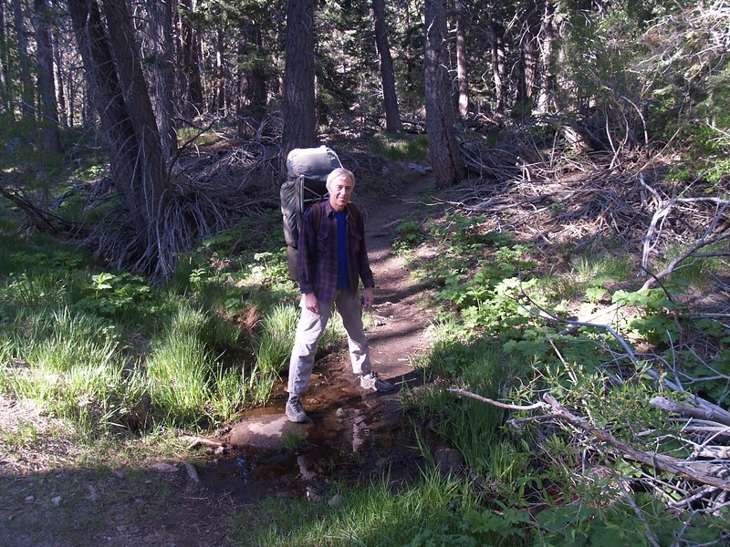 Me and my trusty old backpack as I straddle a tiny stream on the Fish Creek Trail
