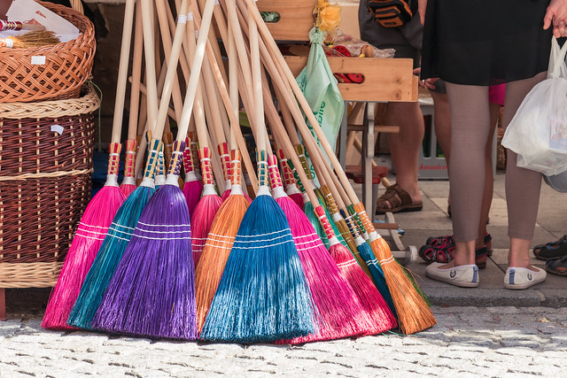 Coloured brooms for witches in colour.