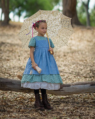 Girl With The Golden Umbrella