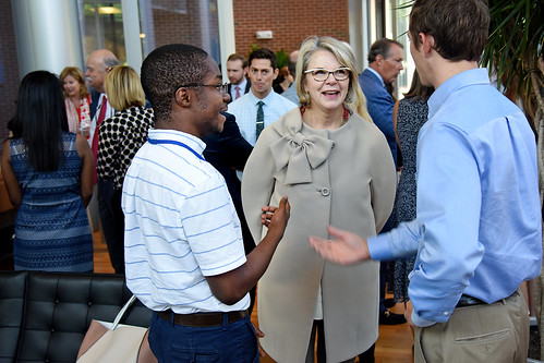 UNC system president Margaret Spellings (center) chats with IAA students.