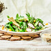 Healthy green salad with avocado, mangold leaves and crispy crackers.
