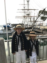 Some young hands in front of the Pilgrim. A replica of the ship that brought Richard Dana to this cove around 1835. The replica Pilgrim was built in 1945.