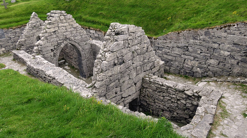 Sunken stone church in the cemetery on the Aran Island of Inisheer in Ireland