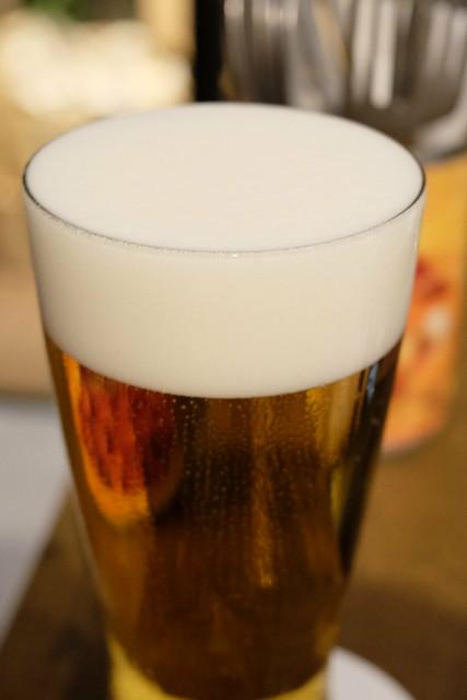 very creamy Asahi super dry draft beer