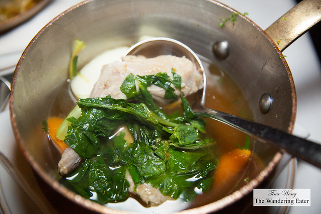 Hind leg of rabbit with Swiss chard, carrots and radishes served in its stock