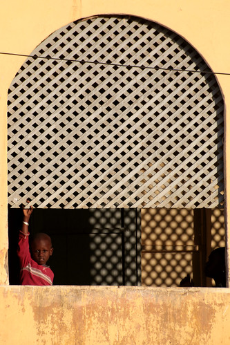 boy people woman profilesilhouette window podor senegal sahel africa westafrica decay yellow wall shadow persiana gelosia jalousie blind child mother son home