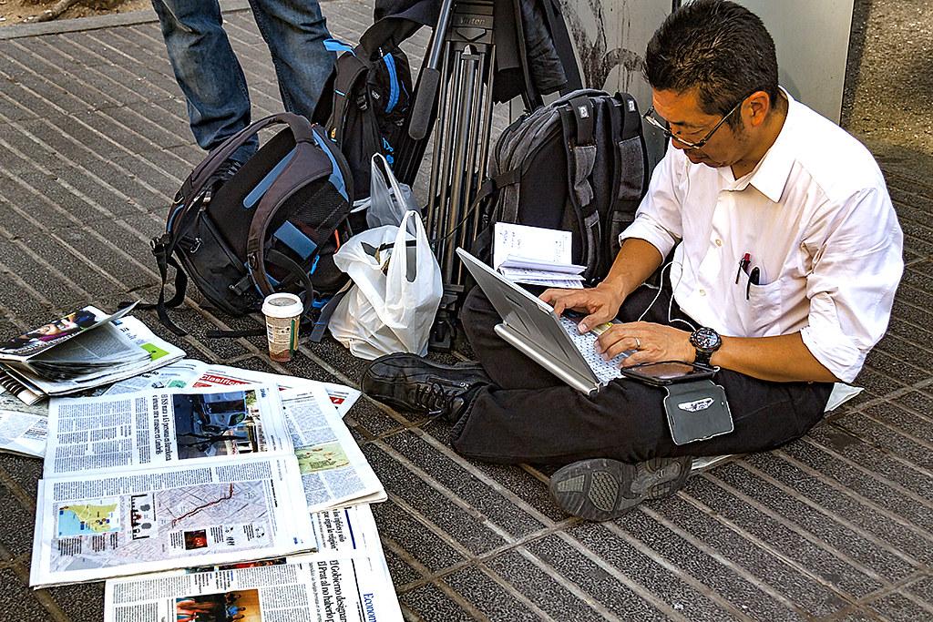 Japanese reporter on La Rambla--Barcelona