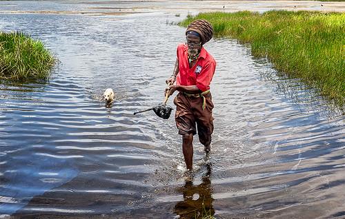 trinidadandtobago tt pitchlake pitch lake asphalt d7001835g man dog trinis trinidadian water caribbean