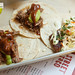 Duo of lamb barbacoa tacos and blackened fish taco