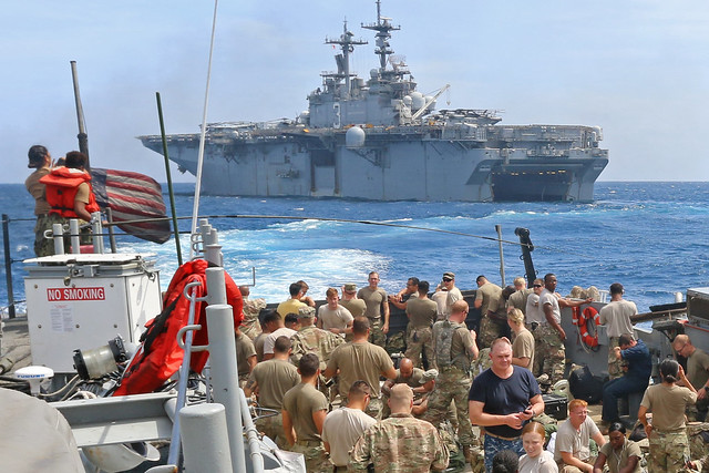 U.S. Army Soldiers aboard a landing craft, utility in the Caribbean Sea.