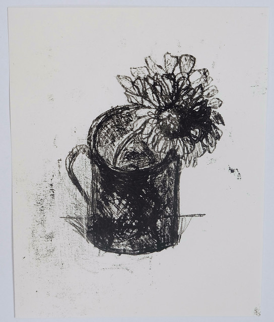 zinnias in a cup