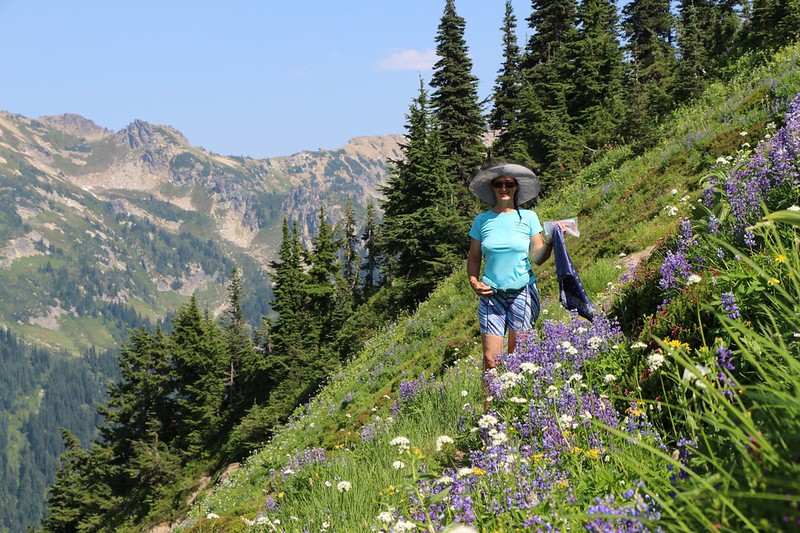 Vicki's blue outfit goes well with the lupine flowers on the High Pass Trail