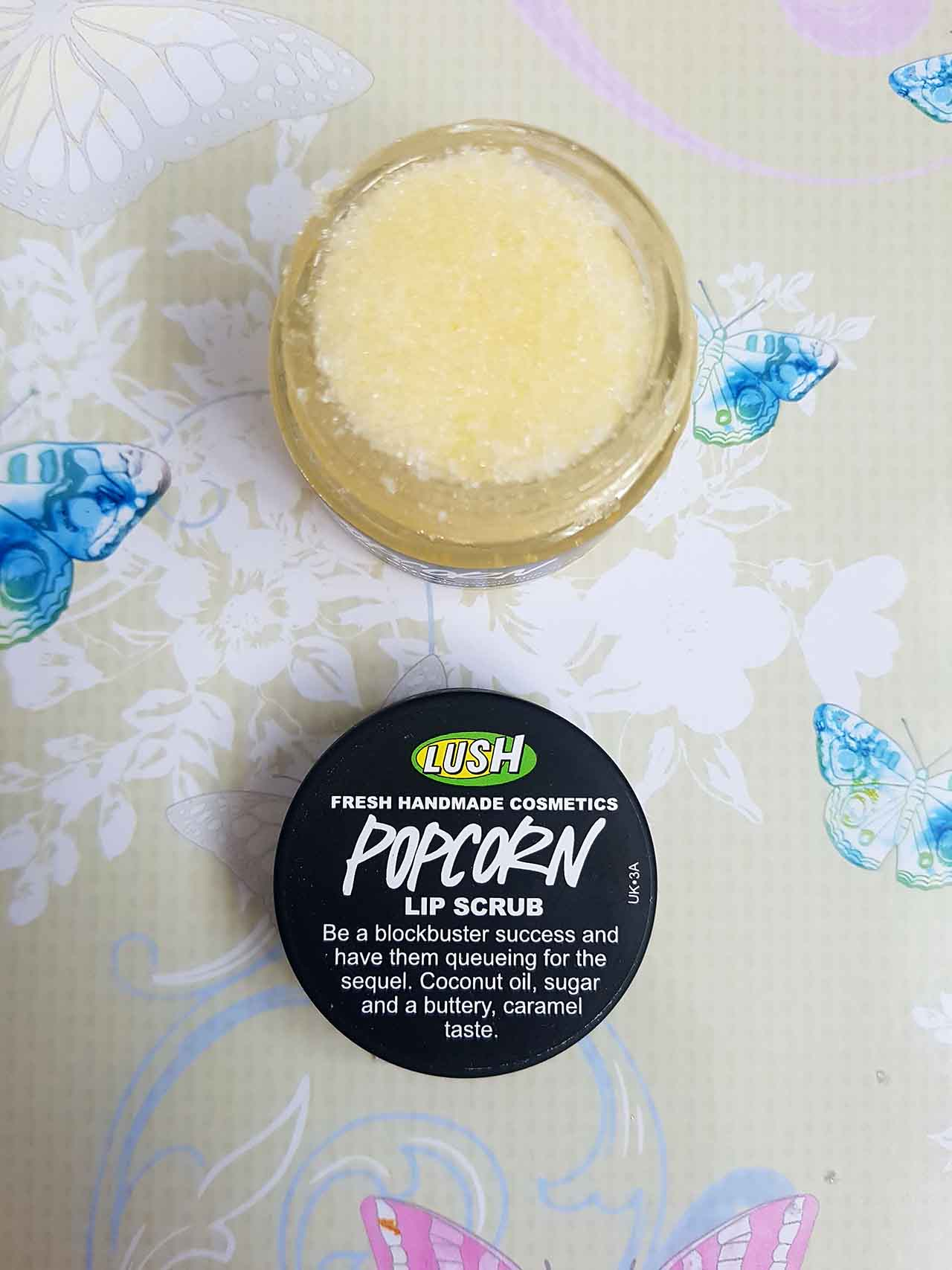 Lush Fresh Handmade Cosmetics – How Lush Are They: The Popcorn Lip Scrub - This lip scrub is designed to soften and moisturize your lips. It contains coconut oil, polenta and popping candy! All the ingredients result in a caramel tasting and smelling edible scrub and it's just lovely. My lips definitely felt soft and smooth after use and you don't even need to rinse your lips after using it as you can just eat what's on your lips and let the oil that remains sink into the skin! The texture of the scrub is grainy but not too harsh or abrasive and you only need a tiny amount each time you use it.