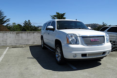 GMC Denali taking two parking spaces Daly City California 170724-110619 C4
