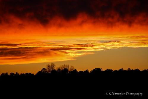 sun sunlight sunset redsky orangesky cloudy clouds landscape trees silhouette fire evansga georgia georgiausa skyline cityscape canont5i canon canon700d