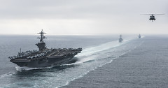In this file photo, ships of the Theodore Roosevelt Strike Group conduct a strait transit exercise in August. (U.S. Navy/MC2 Paul L. Archer)