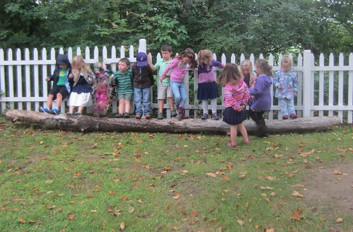 teamwork to move the big log - step one - push with your feet