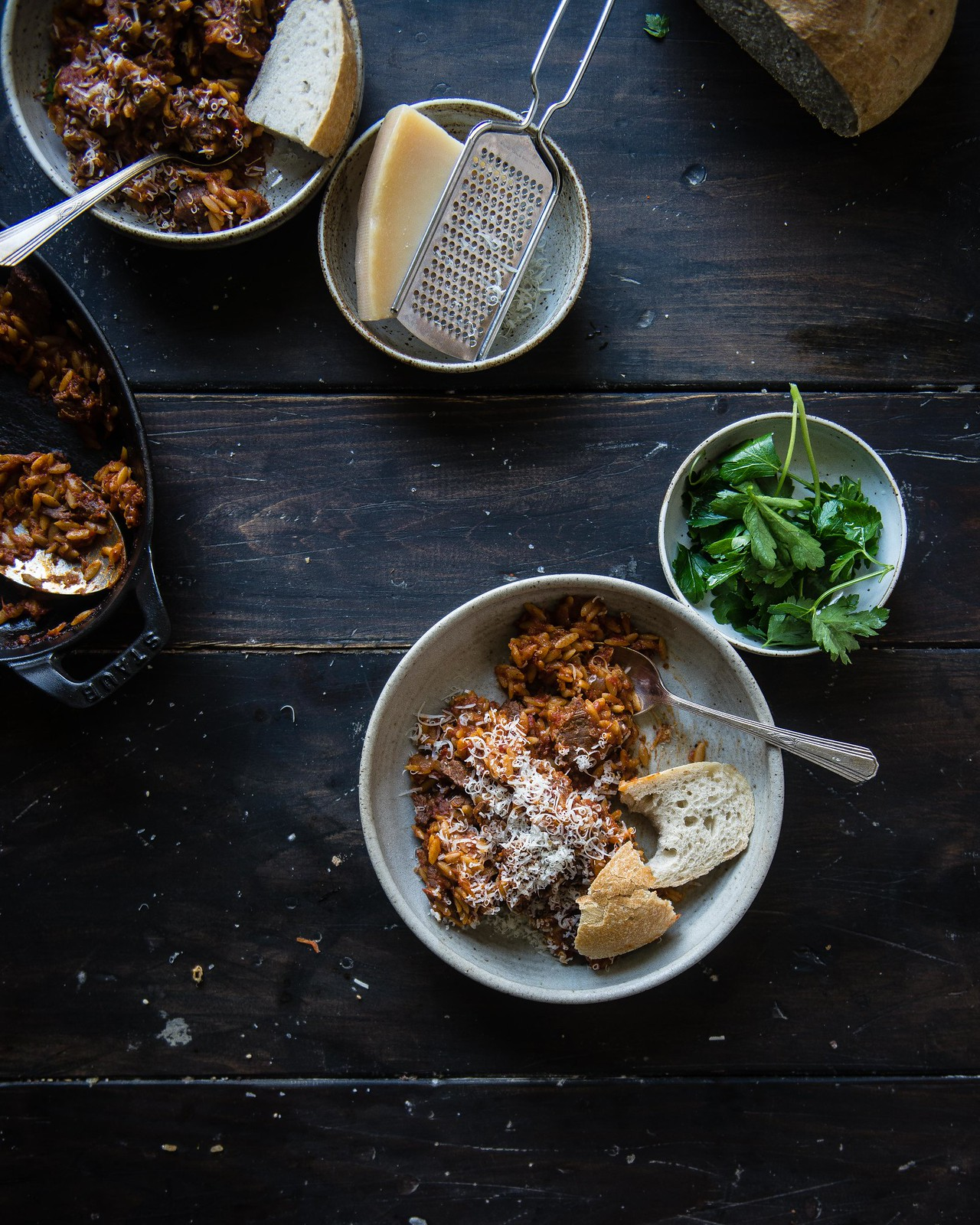 braised beef and orzo   two red bowls