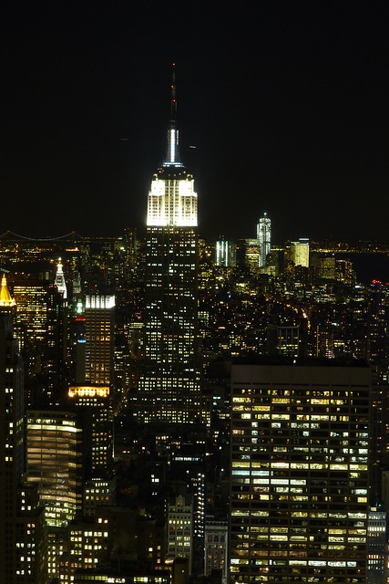 Empire State Building NHL & NHP lighting in white as seen from Top of the Rock in the Theater District of Midtown Manhattan in New York City, NY