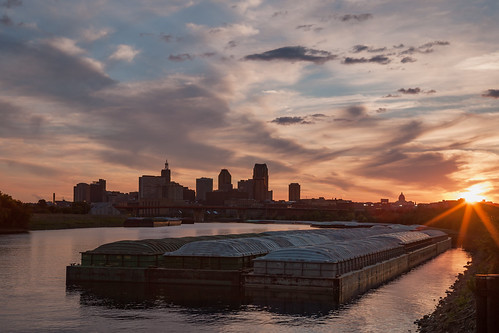 sunset stpaul mississippiriver barges downtown