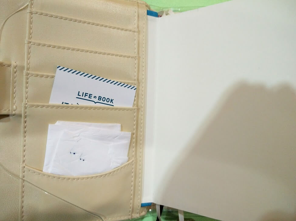 Inside pocket keeps the original insert and a tissue for the gel pens