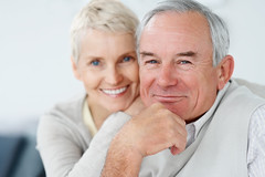 Happy elderly couple smiling together