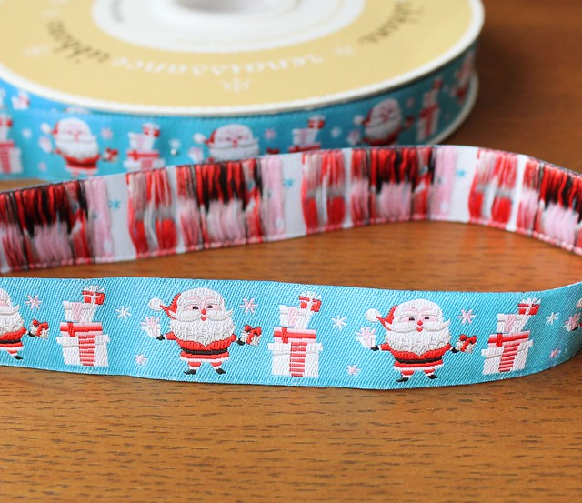 Renaissance Ribbons Santa and Gifts on Turquoise