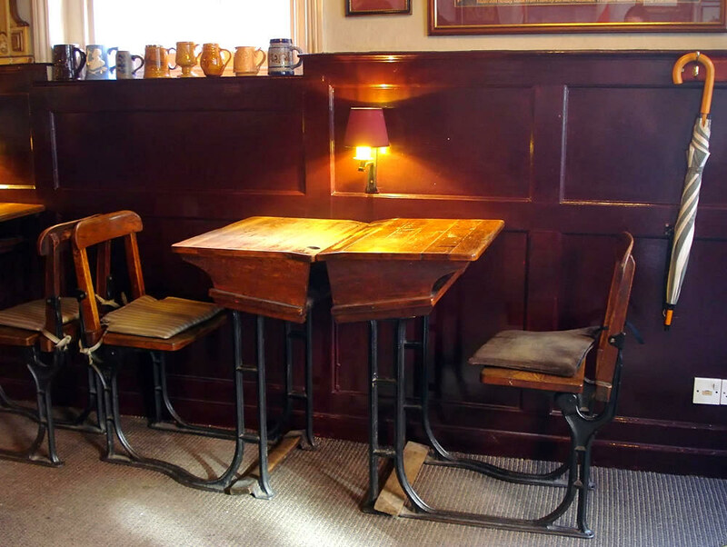 Inside the Wycham Arms pub with old school desks. Credit Kake, flickr