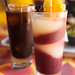 Tsunami - frozen house margarita and red sangria layered and iced coffee