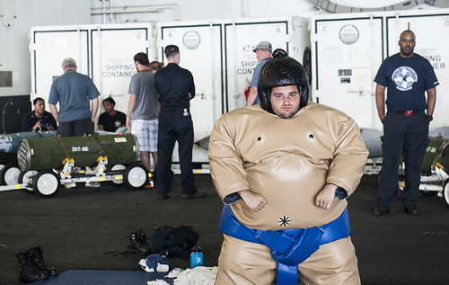 Sun, 08/20/2017 - 21:59 - 170820-N-RZ514-037 ATLANTIC OCEAN (Aug. 20, 2017) Nicolas Vigilant prepares to wrestle in a sumo suit as part of a Tiger Cruise aboard the aircraft carrier USS George H.W. Bush (CVN 77). The ship and its carrier strike group are transiting home from a scheduled seven-month deployment in support of maritime security operations and theater security cooperation efforts in the U.S. 5th and 6th Fleet areas of responsibility.  (U.S. Navy photo by Mass Communication Specialist Seaman Jennifer M. Kirkman/Released)