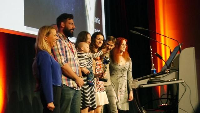DCO team accepts film festival award