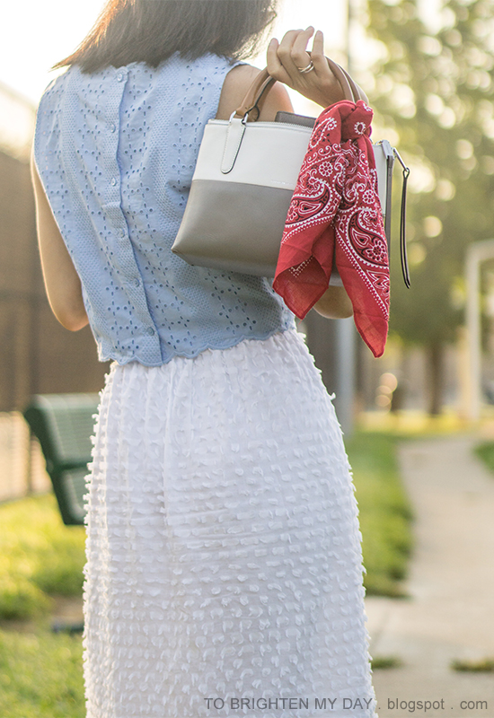 baby blue eyelet sleeveless crop top, white midi skirt in clip dot, colorblocked tote, red bandana