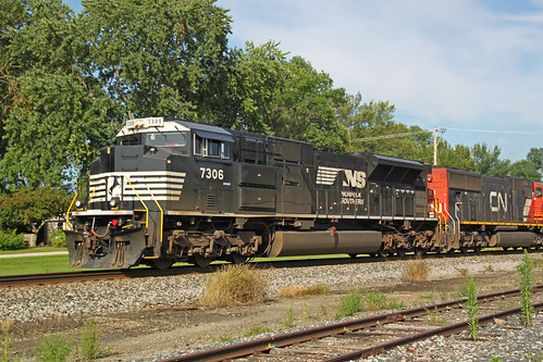 The ex-UP rebuild leading 687 chases the Amtrak through Doylestown